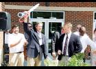 Greer Middle College Board President Eddie Burch, left, and principal Jimmy Armstrong celebrate after cutting the ribbon on the new GMC facility.