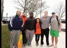 """Miss Greater Greer 2015 Anna Brown, center, with the Clemson offensive line. The players participated in Brown's fundraiser """"Freezin' for a Reason."""""""