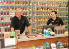 Batteries Plus Bulbs Owner Bates Kennedy, left, recently opened his shop on West Wade Hampton Boulevard in Greer. The store offers 40,000 batteries.