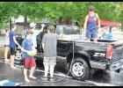 Members of the Byrnes High Rebel Regiment marching band held several car wash fundraisers last Saturday, including this one at the Arby's in Lyman.