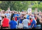 Hundreds of people gathered across the road from Byrnes High School to show their support for the Rebel nickname while the West Spartanburg branch of the NAACP met in Wellford to  determine if they would support removal of the name.