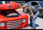 John Horton looks at 1950 red ford truck at His Vineyard's Benefit Car Show Saturday. All proceeds were designated for the church's youth trip to the 2015 Forward Conference.