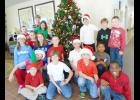 Chandler Creek student council members visited Alpha Health and Rehab, sang Christmas carols and delivered more than 1,000 Christmas cards made by students.