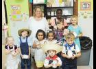 Local students celebrated pioneers last Thursday at Country Day School. Pictured are: Braylon Patters, 2 (front middle); Rose Brown, 3; Ayden Reider, 5; Addison David, 4; Adelyn Davis, 4; Chance Reider, 5 (second row left to right); Michael Poteat, third grade (back row); Mrs. Tracy; Aiyanna Gray, fifth grade; Celeste Poteat, fifth grade.