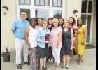 DSS workers won a team award recently. Team members are Devon Holder, Rosalyn Berrios, Maria Gonzalez, Celinda Rodriguez, Olga Rodriquez, Norma Wagner, Patricia Zurita, Yolanda Holmes, Deborah Black and Lisa Turner.