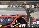 Martin Truex Jr., driver of the No. 19 Bass Pro Toyota, celebrates after winning the NASCAR Cup Series Blue-Emu Maximum Pain Relief 500 at Martinsville Speedway.