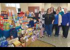 United Community Bank Greer-branch employees recently raised over $3,500 in food and cash donations for Feed the Future.