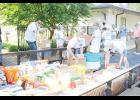 Community members helped to unload Ivey's annual donation at Greer Community Ministries last Friday morning.