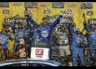 Kevin Harvick, driver of the No. 4 Busch Light Ford, celebrates in victory lane after winning the Monster Energy NASCAR Cup Series KC Masterpiece 400 at Kansas Speedway on May 12 in Kansas City.