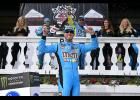 Kyle Busch, driver of the No. 18 M&M's Hazelnut Toyota, celebrates in Victory Lane after winning the Monster Energy NASCAR Cup Series Pocono 400 at Pocono Raceway in Long Pond, Pennsylvania.