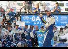 Chase Elliott, driver of the No. 9 NAPA Auto Parts Chevrolet, celebrates in Victory Lane after winning the Monster Energy NASCAR Cup Series Gander Outdoors 400 at Dover International Speedway on Oct. 7.