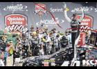 Jimmie Johnson, driver of the No. 48 Lowe's/Kobalt Tools Chevrolet, celebrates in victory lane after winning the NASCAR Sprint Cup Series Quicken Loans 400 at Michigan International Speedway on June 15 in Brooklyn, Mich.