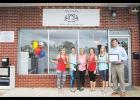 Melanie Boulos celebrated the opening of her yoga studio on Poinsett Street in Greer with a ribbon cutting on Monday.