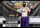 Denny Hamlin, driver of the No. 11 FedEx Office Toyota, celebrates in Victory Lane after winning the NASCAR Cup Series Super Start Batteries 400 Presented by O'Reilly Auto Parts at Kansas Speedway.