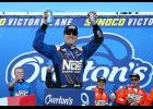 Kyle Busch, driver of the No. 18 NOS Energy Drink Toyota, celebrates in Victory Lane after winning the NASCAR XFINITY Series Overton's 200 at New Hampshire Motor Speedway on July 15 in Loudon, New Hampshire.
