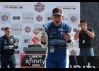 AJ Allmendinger, driver of the No. 16 RAMCO Specialties Inc Chevrolet, celebrates in victory lane after winning the NASCAR Xfinity Series B&L Transport 170 at Mid-Ohio Sports Car Course in Lexington, Ohio.