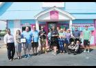 Will Freeman, Owner of Pelican's SnoBalls, celebrated the opening of his second Greer location with a ribbon cutting Tuesday. The Greater Greer Chamber of Commerce, Greer Development Corporation and other community members were also present.