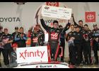 Cole Custer, driver of the No. 00 Haas Automation Ford, poses with the Dash 4 Cash check after winning the NASCAR Xfinity Series ToyotaCare 250 at Richmond Raceway.