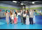 Generation Kid Strong Founder Lisa Salas cut the ribbon on her new location and received her first dollar of profit from the Greater Greer Chamber of Commerce last Friday.