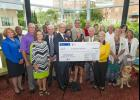 The 14th BMW Charity Pro-Am raised more than $830,000 for Upstate charities. Charity representatives accepted checks at an event in downtown Greenville last week.