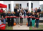 Sir George's White House Salon celebrated its new location in downtown Greer with a ribbon cutting on Sunday. Pictured from left to right: Justin Burnett, Janet Burnett, Pam Sloan, George D. Davis, Brooke Mosteller  Miss South Carolina 2013, Salon owner Colt Davis, Lindsey Burdine, and Vanessa Arrowood,
