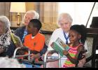Small Impressions students have been practicing their reading with the residents of Greenville Place on Pelham Road all summer.