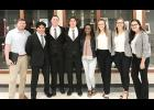 Greer High's VE class, which won state earlier this month, is now preparing for nationals in April. From left to right:  VE Teacher Brad Redd; COO Ellison Flores; CEO Matthew Huff; Garrett Dill, VP of Accounting; Kamille Bush, HR Director; CFO Emily Jordan; CMO Ivey Bennett; and Celeste Ruiz-Sarmiento, Director of Advertising.