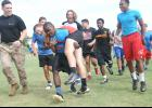 The Riverside High School football team got a taste of Marine Corps training last week during a program concluding summer sessions for the Warriors. Marine instructors worked with the players for nearly two hours, leading them through various physical challenges.