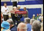 Greer Fire Chief Chris Harvey holds up one of the many items that were auctioned off last week at Big Thursday.