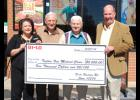 Karen Salerno, left to right, Russell Ashmore and Larry Copeland with Taylors Free Medical  Clinic receive a $5,000 check from BI-LO Manager Keith Wilder, far right.