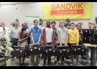 Business and school officials joined the Bonds Machine Tool students as they received the gifted tools and boxes.
