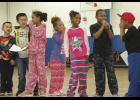 Students at the Creative Advancement Centers celebrated Christmas early at their annual Christmas Program where they performed poems, songs, skits and received presents.