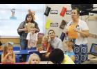 Crestview Elementary held its annual Meet the Teacher night for K4 and K5 students Thursday. Kindergarten teacher Colleen Kimbler reviews paperwork with parents.