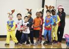 A group of gradeschoolers performed popular Christmas carols, such as 'Rudolph the Red Nose Reindeer' Friday.