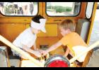 Nicolas May, left, and Greyson Ledford played as train conductors in a motorcar during RailFest.