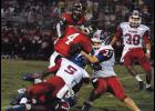 Riverside's Bennett Von Waldner and Jeremiah Bogan swarm a Hillcrest ball carrier during Friday night's 38-0 loss.