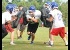 The hits have begun for Riverside. The Warriors began their first full week of practice on Monday morning at the middle school practice field.