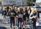 The Greer High School volleyball team made its contribution to the annual Syl Syl Christmas Toy Drive last Sunday afternoon at the Clock restaurant in Greer.