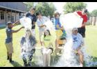 """Challenge accepted: Bonds Career Center teachers Heather Hannon, Anna Chappell and Steve Musco get drenched with cold water doing the """"ALS Ice Bucket Challenge"""" in an effort to raise awareness and funds for Amyotrophic Lateral Sclerosis."""