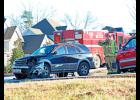Two-car collision: Greer Police and Greenville County EMS responded to a two-car wreck last week on Highway 14 in front of Bojangles.  The woman pictured here was conscious when she was transported via ambulance to the hospital.